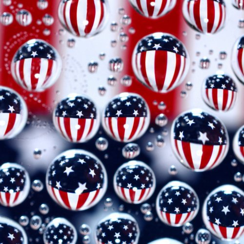 Water Drops Reflecting the American Flag by Jenn Cardinell